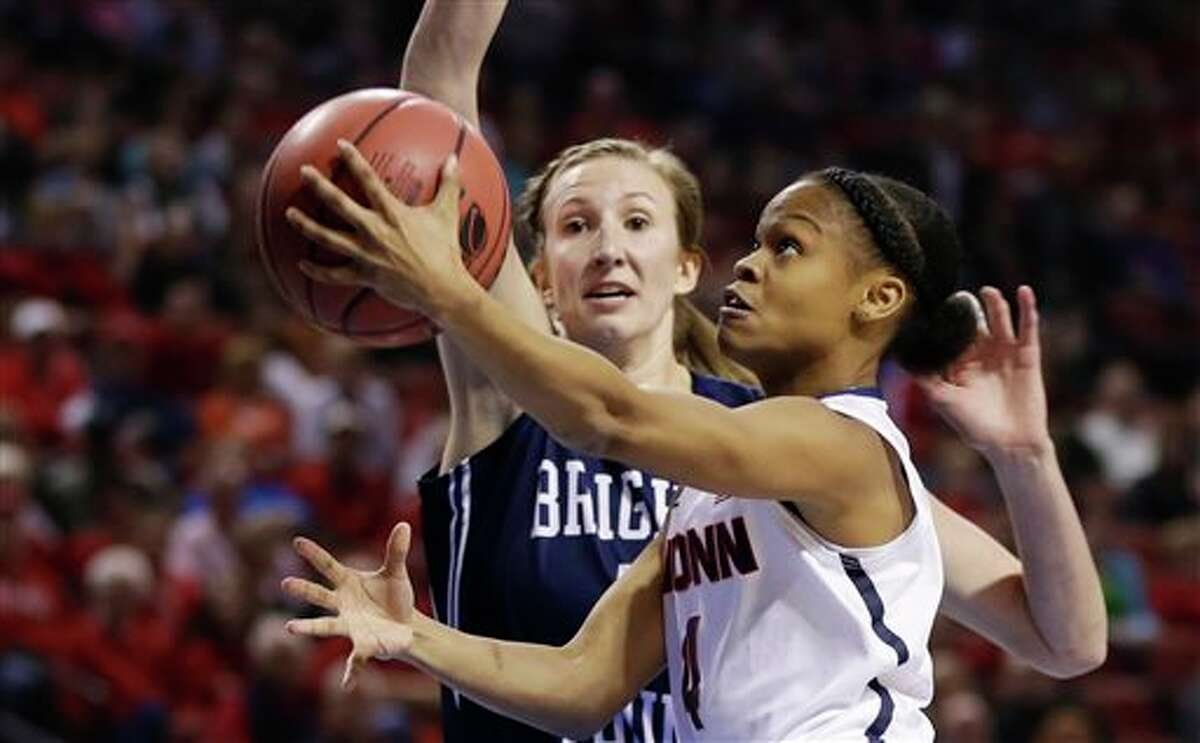 Connecticut's Moriah Jefferson (4) goes for a layup against BYU's Jennifer Hamson, rear, during the first half of a regional semifinal in the NCAA college basketball tournament in Lincoln, Neb., Saturday, March 29, 2014. (AP Photo/Nati Harnik)