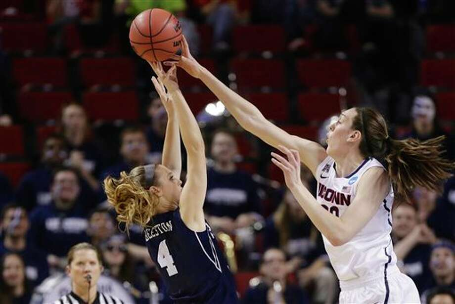 BYU's Kim Beeston (4) is  blocked by Connecticut's Breanna Stewart (30) during the first half of a  regional semifinal game in the NCAA women's college basketball  tournament in Lincoln, Neb., Saturday, March 29, 2014. (AP Photo/Nati  Harnik)