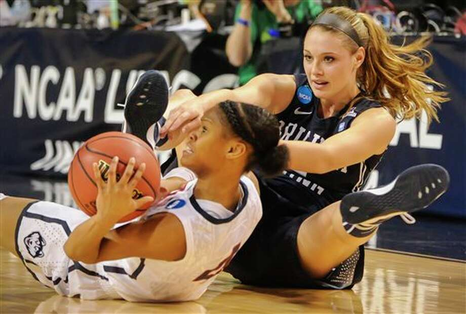 Connecticut's Moriah  Jefferson (4) goes for a loose ball in front of BYU's Kim Beeston (4)  during the first half of a regional semifinal in the NCAA college  basketball tournament Saturday, March 29, 2014, in Lincoln, Neb. (AP  Photo/Dave Weaver)