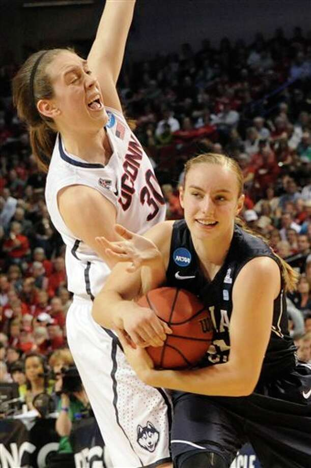 BYU's Lexi Eaton, right, gets  tangled with Connecticut's Breanna Stewart (30) during the first half  of a regional semifinal in the NCAA college basketball tournament  Saturday, March 29, 2014, in Lincoln, Neb. (AP Photo/Dave Weaver)