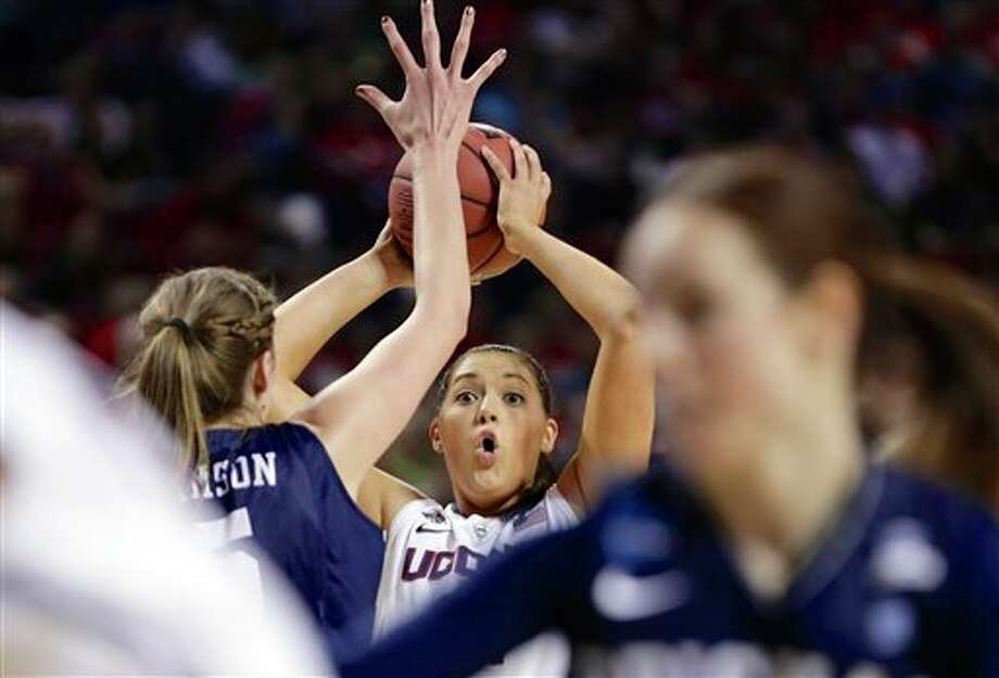 Connecticut's Stefanie  Dolson, center, defended by BYU's Jennifer Hamson, second left, looks to  pass during the first half of a regional semifinal in the NCAA college  basketball tournament in Lincoln, Neb., Saturday, March 29, 2014. (AP  Photo/Nati Harnik)