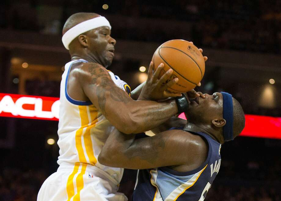 The Warriors might need Jermaine O'Neal (left), struggling with Zach Randolph, to help fill a void in the middle. Photo: Kelley L Cox, Reuters