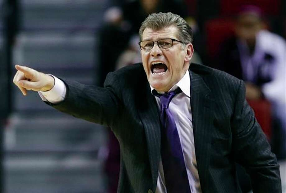 Connecticut coach Geno  Auriemma yells instructions to his players during the second half of a  regional semifinal against BYU at the NCAA college basketball tournament  in Lincoln, Neb., Saturday, March 29, 2014. (AP Photo/Nati Harnik)
