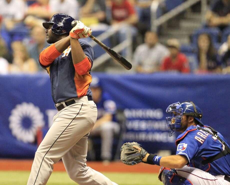 March 29: Astros 13, Rangers 5Chris Carter of the Astros hits a three-run home run against the Rangers. Photo: Karen Warren, Houston Chronicle