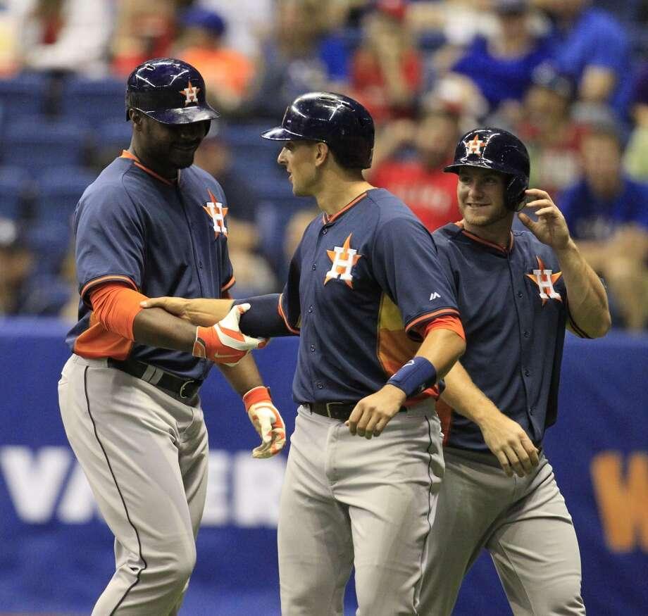 Astros catcher Jason Castro congratulates Chris Carter after his three-run home run against the Rangers. Photo: Karen Warren, Houston Chronicle