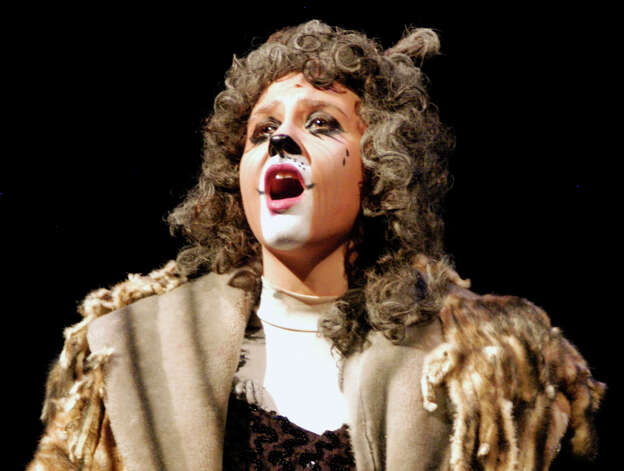 "Caitlyn Lalli offers a powerful rendition of ""Memory"" in her role as Grizabella the Glamour Cat during rehearsal for New Milford High School's production of Andrew Lloyd Webber's musical, ""Cats."" March 17, 2014 Photo: Norm Cummings / The News-Times"