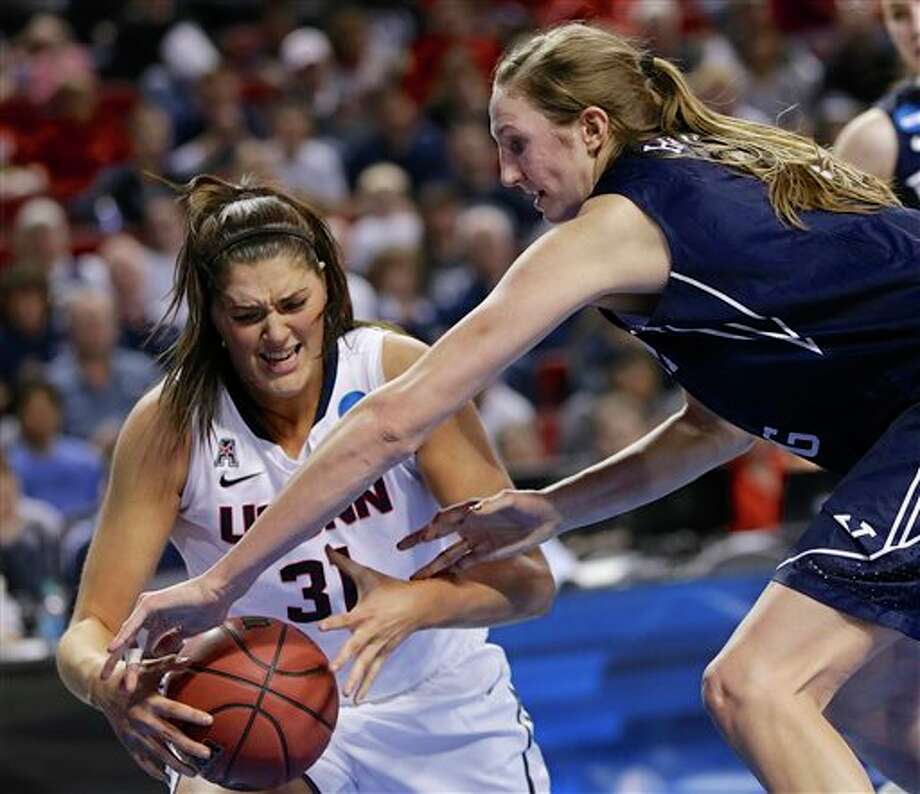 Connecticut's Stefanie Dolson  (31) is fouled by BYU's Jennifer Hamson (5) during the second half of a  regional semifinal in the NCAA college basketball tournament in  Lincoln, Neb., Saturday, March 29, 2014. (AP Photo/Nati Harnik)