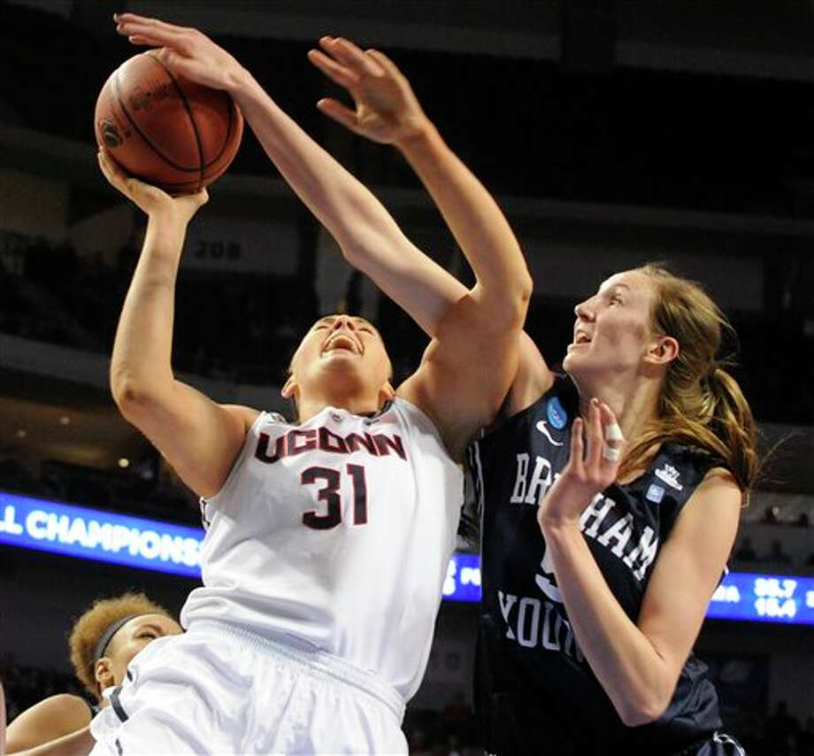 Connecticut's Stefanie Dolson  (31) takes a shot in front of BYU's Jennifer Hamson (5) during the  second half of a regional semifinal in the NCAA women's college  basketball tournament Saturday, March 29, 2014, in Lincoln, Neb.  Connecticut won 70-51. (AP Photo/Dave Weaver)