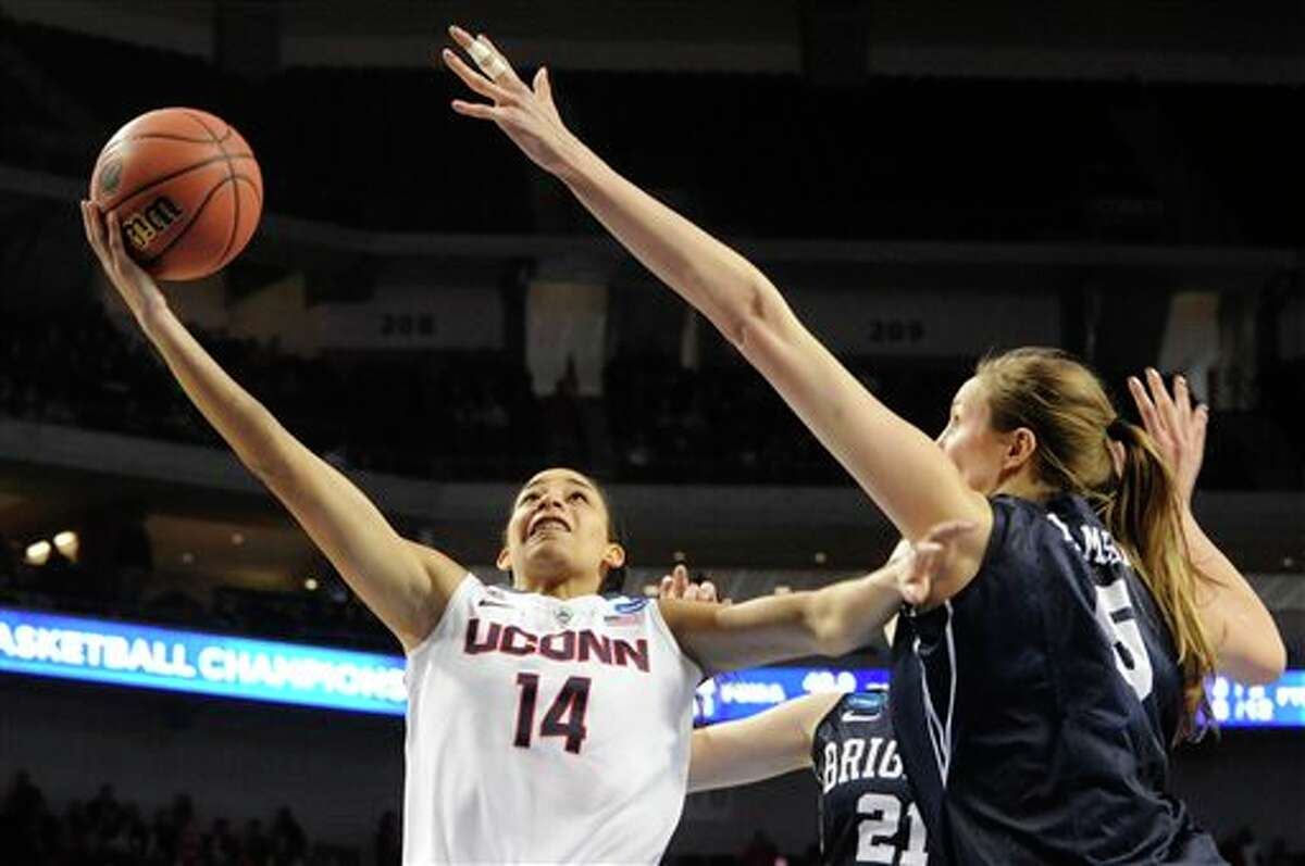 Connecticut's Bria Hartley (14) takes a shot against BYU's Jennifer Hamson (5) during the second half of a regional semifinal in the NCAA women's college basketball tournament Saturday, March 29, 2014, in Lincoln, Neb. Connecticut won 70-51. (AP Photo/Dave Weaver)