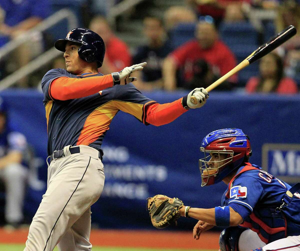 Outfielder George Springer, above, won't start the season in an Astros uniform, but fans eagerly anticipate his arrival, along with first baseman Jon Singleton and shortstop Carlos Correa.