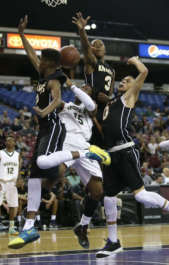 Moreau Catholic guard Armond Simmons (center) loses the ball as he tries to drive to the basket between three Bishop Montgomery defenders. Photo: Rich Pedroncelli, Associated Press