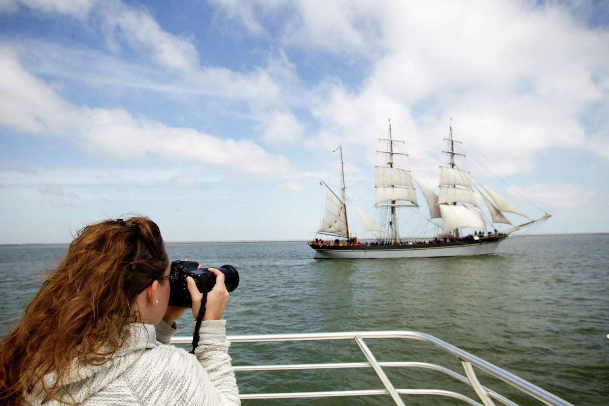 Christa Schreckengost takes photos of the 1877 tall ship Elissa as she sets sail for the first time in more than four years Saturday, March 29, 2014, in Galveston. Elissa once again returned to the open waters of the Gulf of Mexico with guests and supporters aboard for a first hand look at her completed restoration.