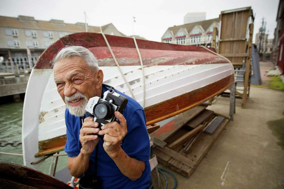 Marcelo Moreno gets ready to take a photo of the 1877 tall ship Elissa before she sets sail for the first time in more than four years Saturday, March 29, 2014, in Galveston. Elissa once again returned to the open waters of the Gulf of Mexico with guests and supporters aboard for a first hand look at her completed restoration. Photo: Brett Coomer, Houston Chronicle / © 2014 Houston Chronicle