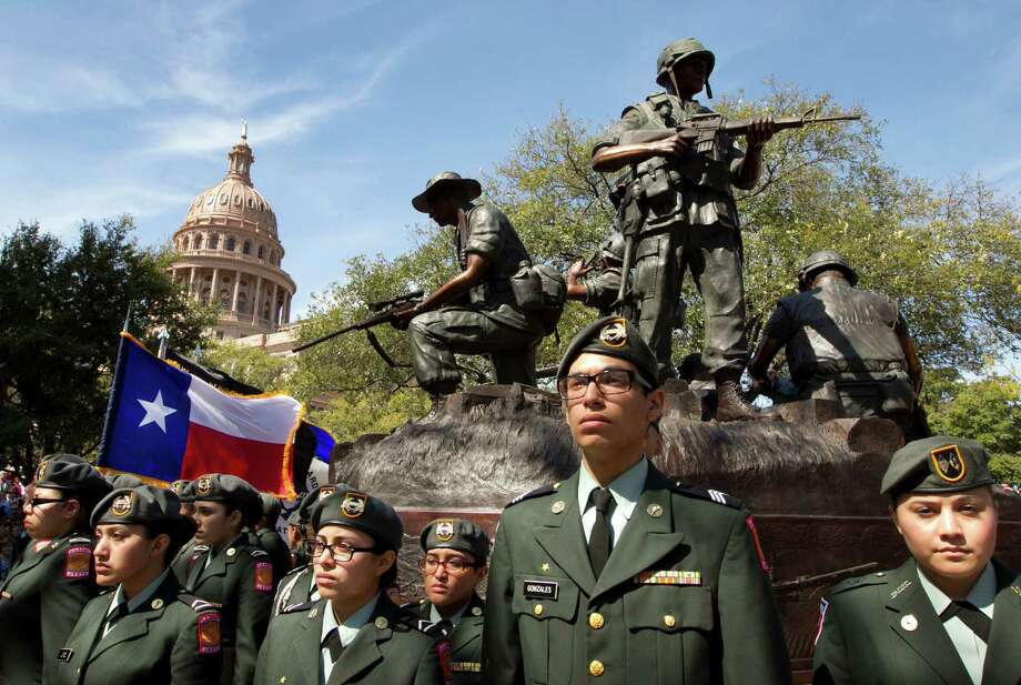 Members of the Memorial High School JROTC Minutemen Battalion from San Antonio participate in the dedication of the Texas state Capitol Vietnam Veterans Monument in Austin. Photo: Jay Janner, MBI / Austin American-Statesman