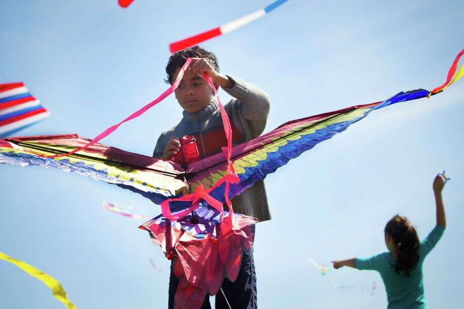 Ahmed Hassan, 8, untangles the tail of his kite as he tries to to make his kite pick up wind to elevate during the Hermann Park Kite Festival, Saturday, March 29, 2014, in Houston. Photo: Marie D. De Jesus, Houston Chronicle / © 2014 Houston Chronicle