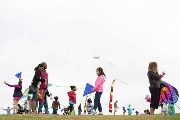 Families elevate their kites above Hermann Park near the Miller Outdoor Theater, Saturday, March 29, 2014, during the Hermann Park Kite Festival in Houston.
