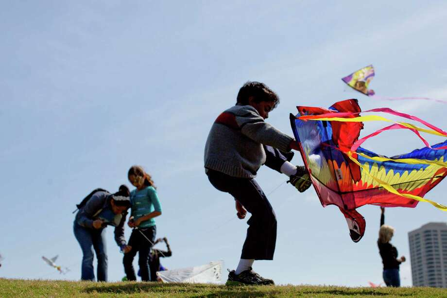 Ahmed Hassan, 8,  unravels himself from the line of the kite during one of his many attempts to fly his kite at the Hermann Park Kite Festival, Saturday, March 29, 2014, in Houston. Photo: Marie D. De Jesus, Houston Chronicle / © 2014 Houston Chronicle