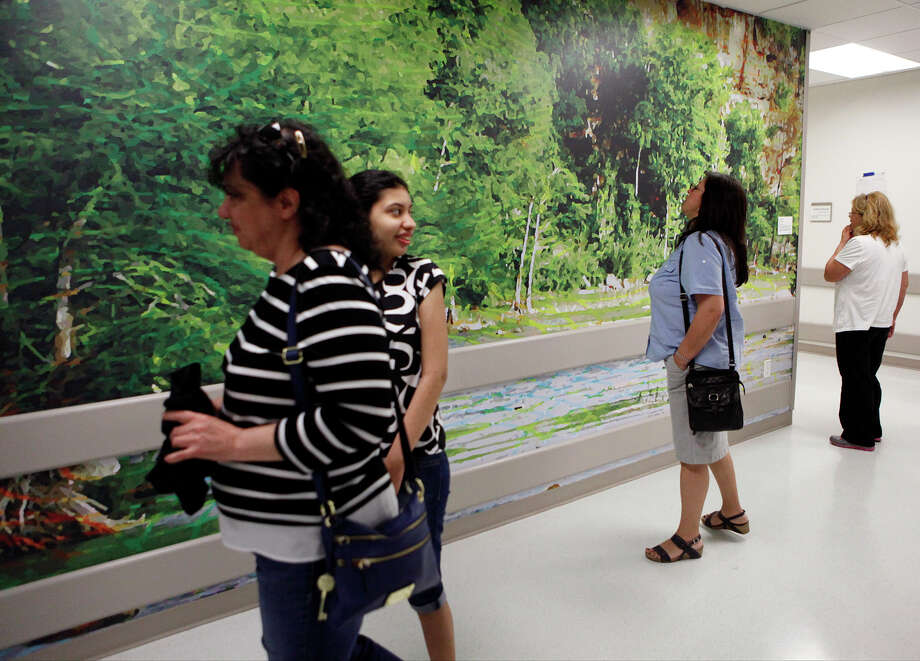 Irma Gutierrez (middle) stops to looks at the artwork on the wall in the Emergency Room wall March 29, 2014 during her tour of the University Hospital Sky Tower. Photo: Cynthia Esparza, FOR THE SAN ANTONIO EXPRESS-NEWS / FOR THE SAN ANTONIO EXPRESS-NEWS