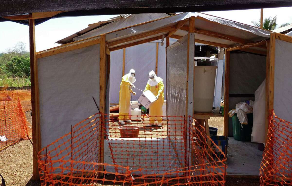 In this photo provide by MSF, Medecins Sans Frontieres (Doctors without Borders), taken on Friday, March 28, 2014, healthcare workers from the organisation prepare isolation and treatment areas for their Ebola, hemorrhagic fever operations, in Gueckedou, Guinea. Health officials in the West African nation of Guinea say they're now treating eight cases of Ebola in the capital. Dr. Sakoba Keita, a spokesman for the health ministry, announced on national television the virus had reached the city of 3 million. Keita said Friday, March 28, 2014, at least 70 people have died in the country's south since the Ebola outbreak began last week. (AP Photo/Kjell Gunnar Beraas, MSF) ORG XMIT: AEBO102