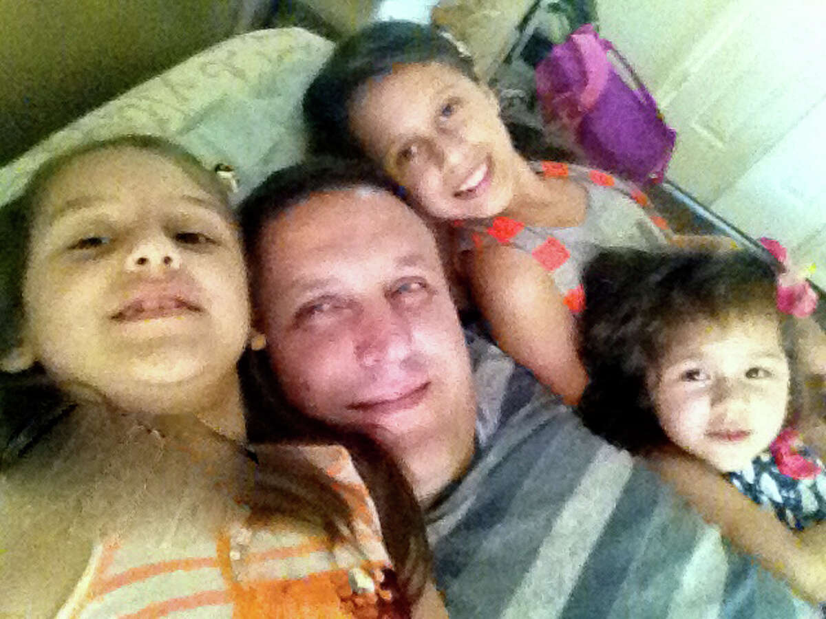Kemal Yazar, pictured with his children, was shot to death in 2012 by sheriff's deputies in Katy.