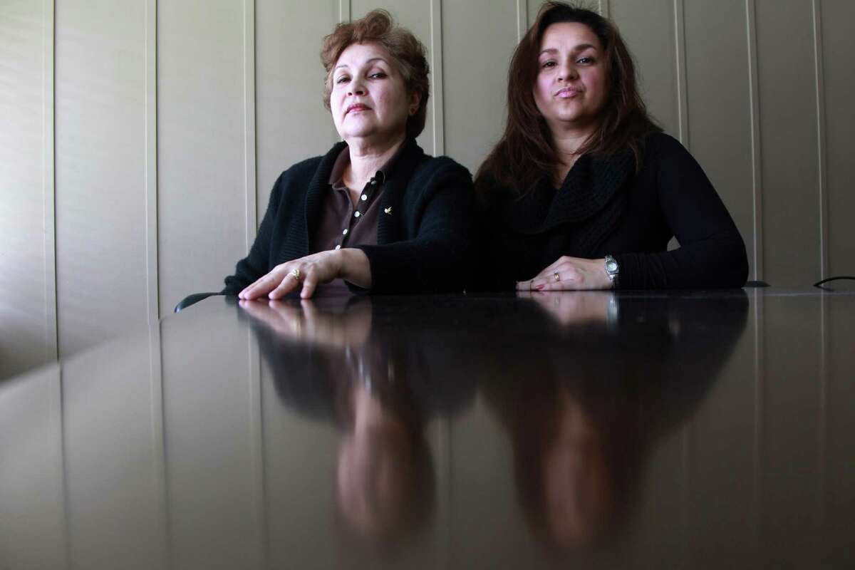 Carmina Figueroa, sitting next to daughter Marlene Yazar, is being sued by Harris County Sheriff's Deputy Brady Pullen in the aftermath of a shooting at her home that left her son in law - Yazar's husband - dead.