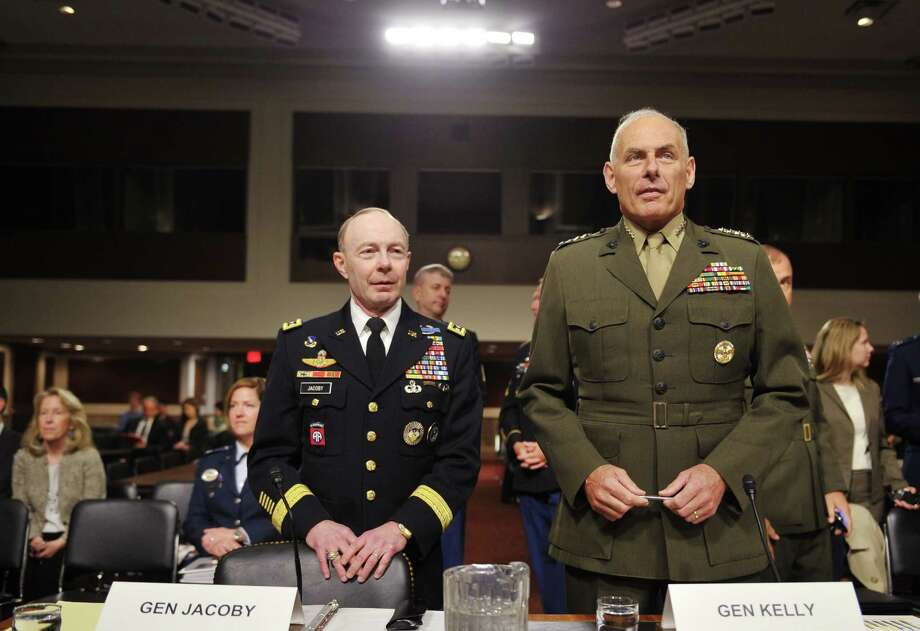 Marine Corps General John Kelly (R), commander of the US Southern Command, stands next to Army General Charles Jacoby (L), commander of the US Northern Command and commander of the North American Aerospace Defense Command, before taking their seates to testify to the Senate Armed Services Committee hearing on United States Northern Command and United States Southern Command in review of  the Defense Authorization Request for FY2015 on March 13, 2014 on Capitol Hill in Washington, DC. AFP PHOTO/Mandel NGANMANDEL NGAN/AFP/Getty Images Photo: MANDEL NGAN, AFP/Getty Images / AFP