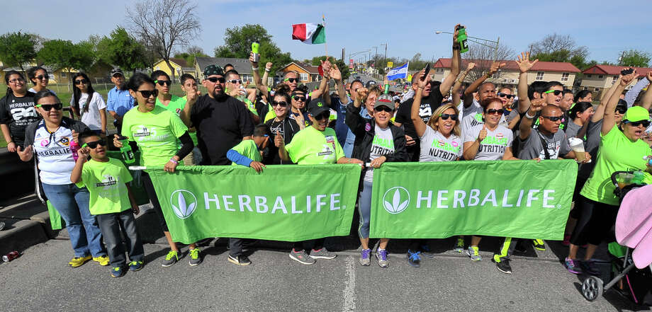 Herbalife took part in the Cesar Chavez March Saturday along Guadalupe St. Photo: Robin Jerstad