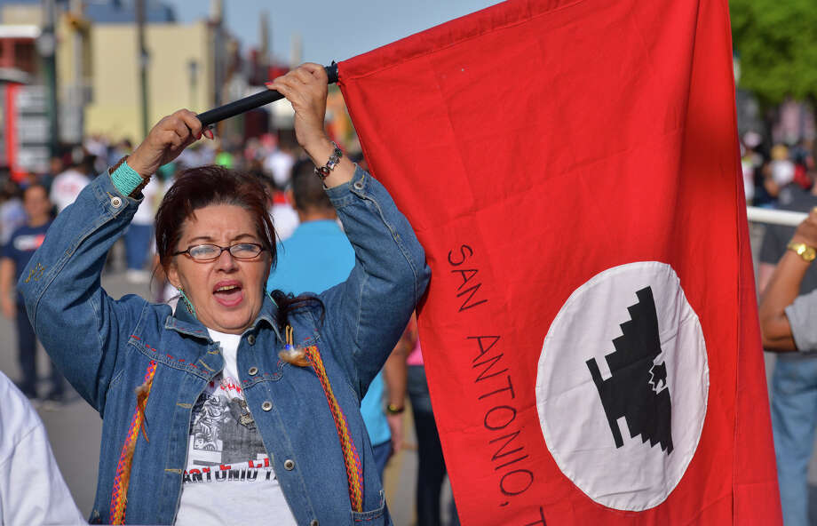 Nancy Palestrant chants prior to the start of the Cesar Chavez March Saturday along Guadalupe St. Photo: Robin Jerstad