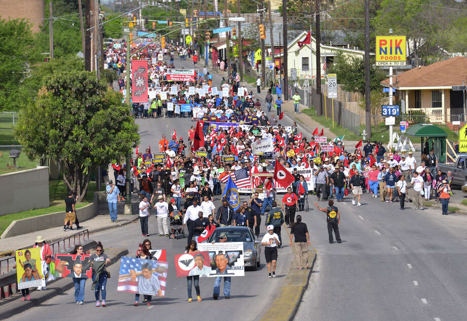 Marchers parade along Guadalupe St. during the Cesar Chavez March Saturday morning. Photo: Robin Jerstad