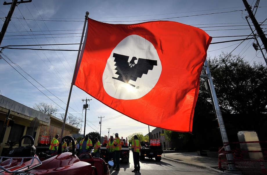 The flag of the United Farmworkers Union flies in the breeze prior to the start of the Cesar Chavez March Saturday along Guadalupe St. Photo: Robin Jerstad
