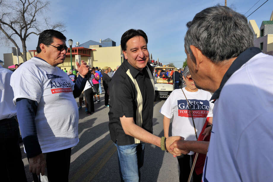 Congressman Pete Gallego shakes hands with supporters prior to the start of the Cesar Chavez March Saturday. Photo: Robin Jerstad