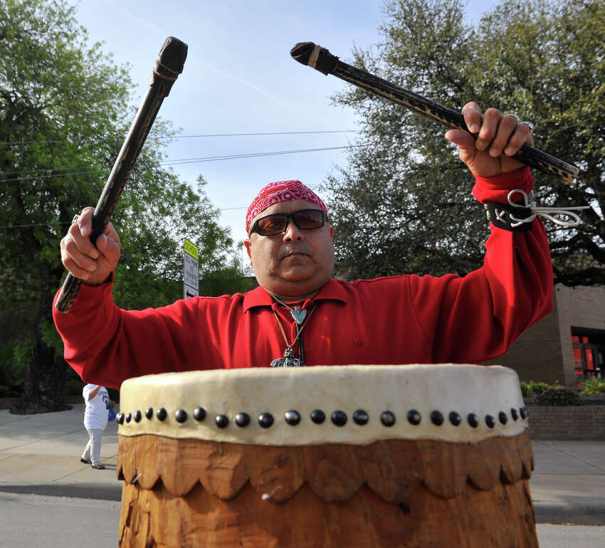 John Hernandez plays drums prior to the start of the Cesar Chavez March along Guadalupe St. Saturday morning.