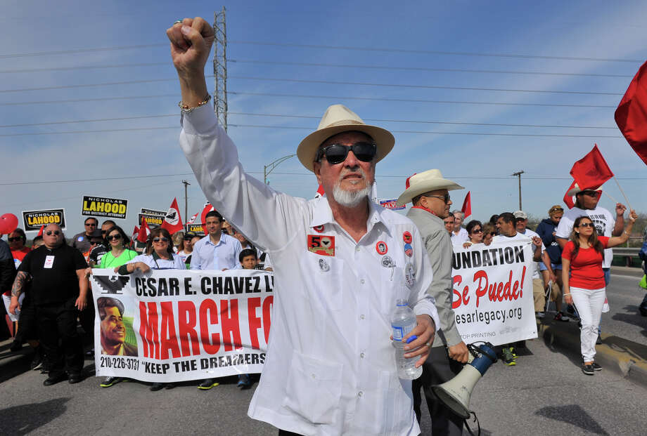 Organizer Jaime Martinez walks at the front of the Cesar Chavez March along Guadalupe St. Saturday. Photo: Robin Jerstad