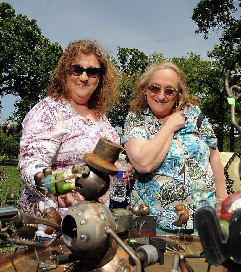Roseann Drake and Catherine Logue look at sculptures at the Bayou City Art Festival at Memorial Park Saturday March 29, 2014. Photo: Dave Rossman, For The Houston Chronicle / Freelance