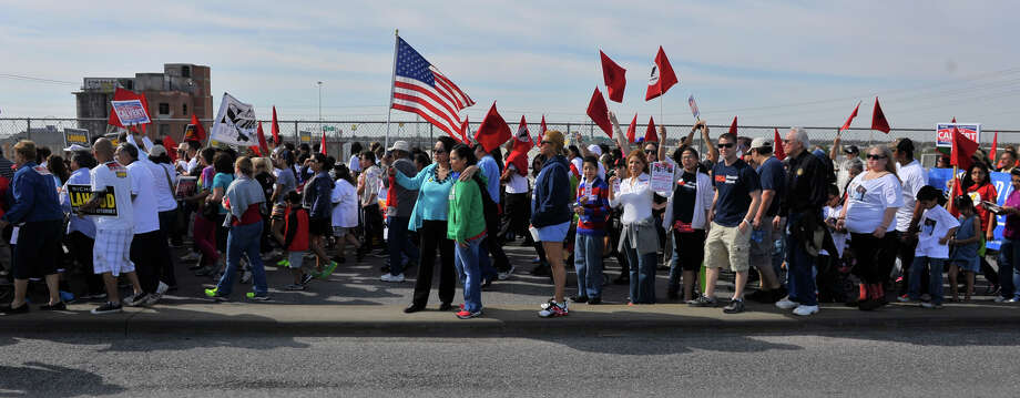 MArchers cross the Guadalupe St. bridge during the Cesar Chavez March Saturday. Photo: Robin Jerstad