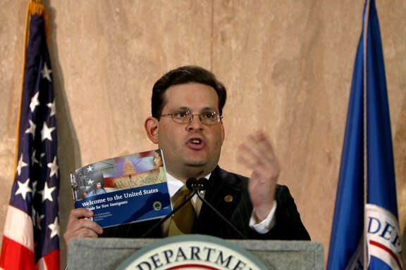 Alfonso Aguilar, head of Homeland Security's Office of Citizenship, displays a new guide, written for recently arrived legal residents, during a news conference, Tuesday, June 7, 2005, in Los Angeles.  The guide comes in response to a massive immigration boom in the last decade and seeks to help immigrants better integrate into American society. Community groups say the guide is a good first step. (AP Photo/Stefano Paltera)