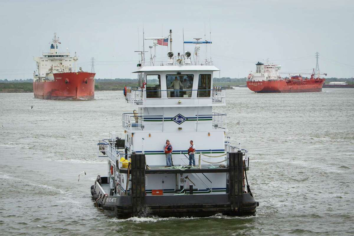A Kirby towboat operates on the Houston Ship Channel, Wednesday, March 26, 2014. Five people typically man the vessel as it transports barges along the waterways.