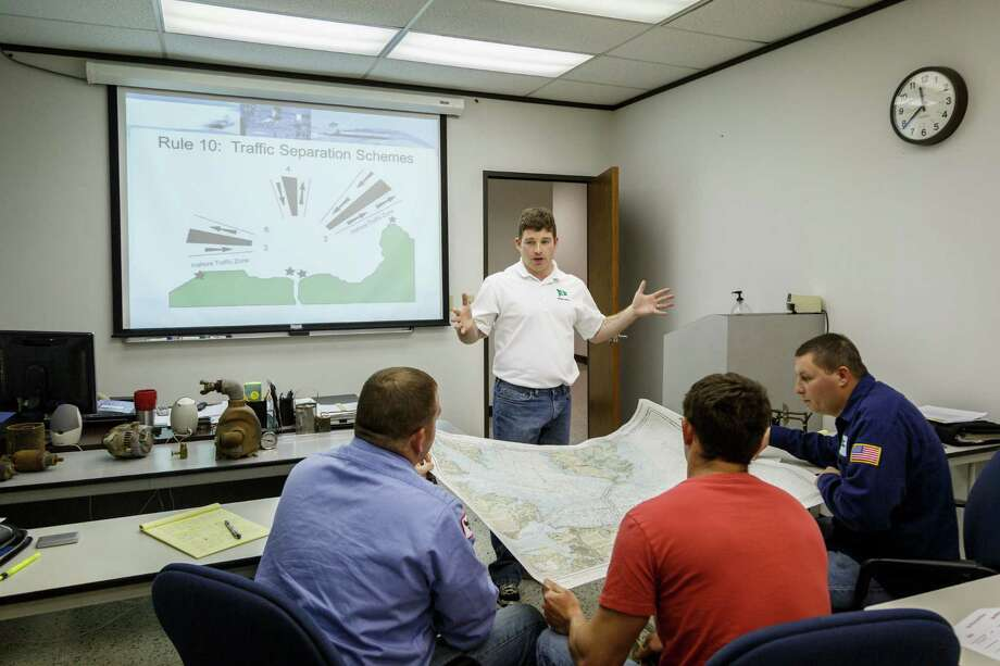 "Instructor, Nick Henrich, teaches a class on ""Navigational Rules of the Road"" to students, Justin Parks, left to right, Lance LeBlanc and Travis Jackson at the Kirby Training Center for marine personnel, Wednesday, March 26, 2014, in Houston. Photo: Michael Paulsen, Houston Chronicle / © 2014 Houston Chronicle"