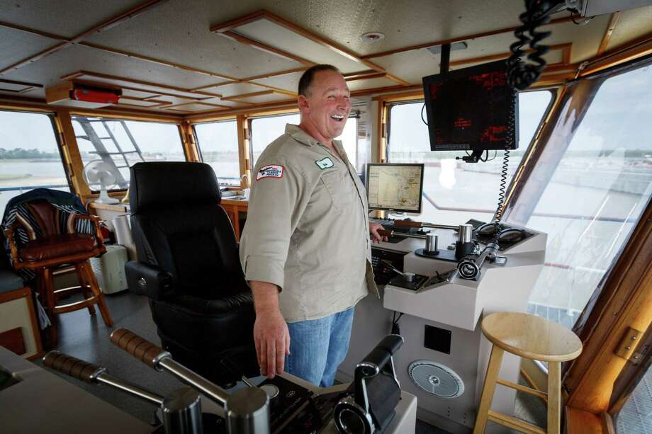 "Captain Cletus Henderson operates a towboat from the wheelhouse of the Motor/Vessel ""Jeff Montgomery"" on the Houston Ship Channel, Wednesday, March 26, 2014. Photo: Michael Paulsen, Houston Chronicle / © 2014 Houston Chronicle"