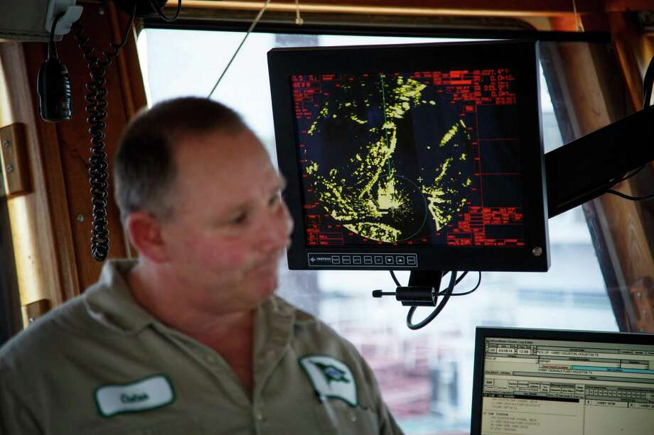 "Captain Cletus Henderson operates a towboat from the wheelhouse of the Motor/Vessel ""Jeff Montgomery"" while standing in front of a radar displaying vessel surroundings while on the Houston Ship Channel, Wednesday, March 26, 2014. Photo: Michael Paulsen, Houston Chronicle / © 2014 Houston Chronicle"