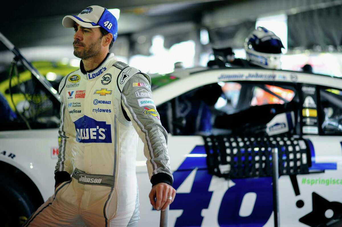 MARTINSVILLE, VA - MARCH 29: Jimmie Johnson, driver of the #48 Lowe's Chevrolet, looks on in the garage area during a rain delay in practice for the NASCAR Sprint Cup Series STP 500 at Martinsville Speedway on March 29, 2014 in Martinsville, Virginia. (Photo by Jared C. Tilton/Getty Images) ORG XMIT: 480964745