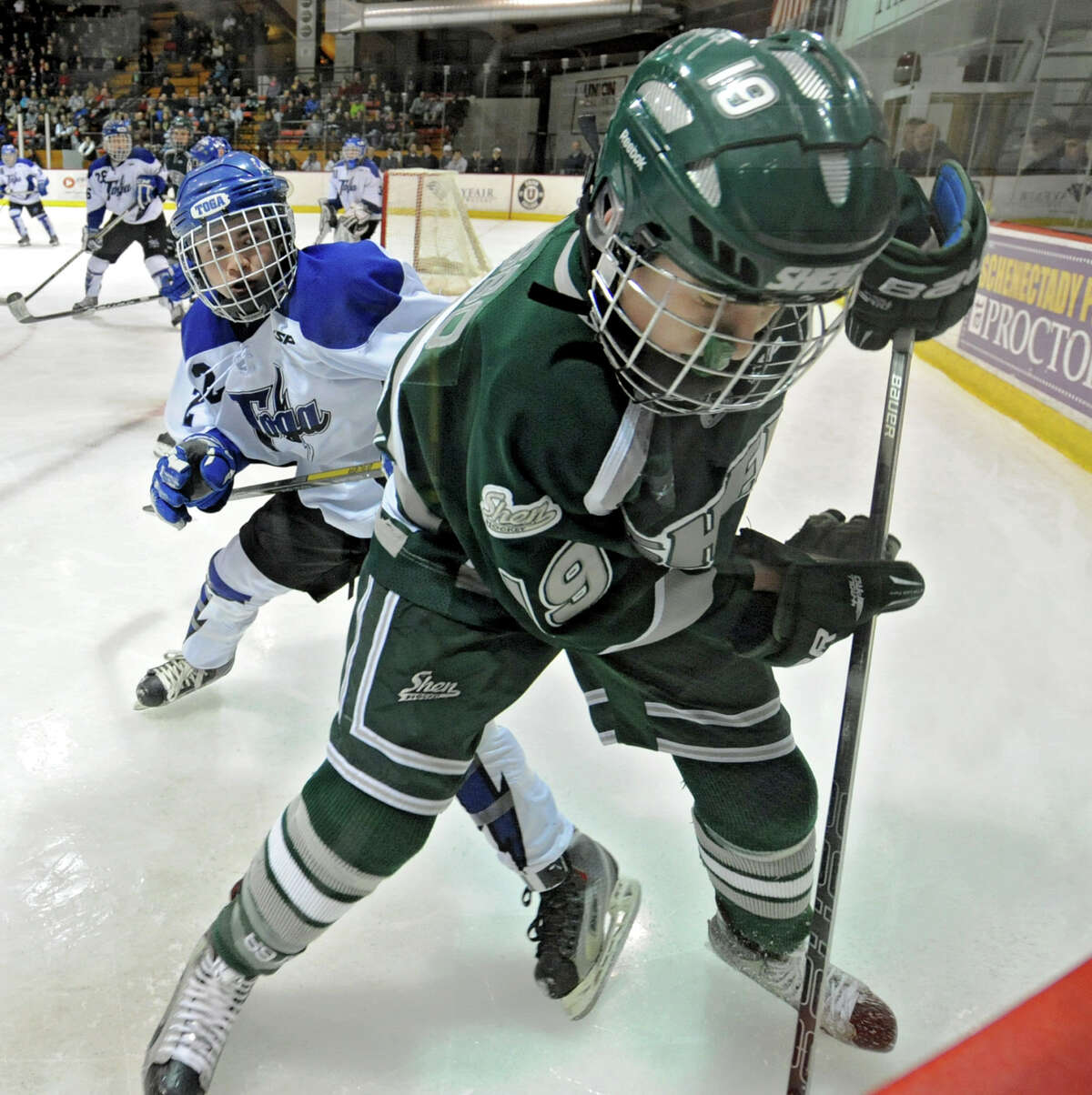 From left, Saratoga's Matt Klingbell battles for the puck with Shenendehowa' s Peter Russo during the section II division I hockey championship game at Union College on Thursday Feb. 21, 2013 in Schenectady, N.Y. (Lori Van Buren / Times Union)
