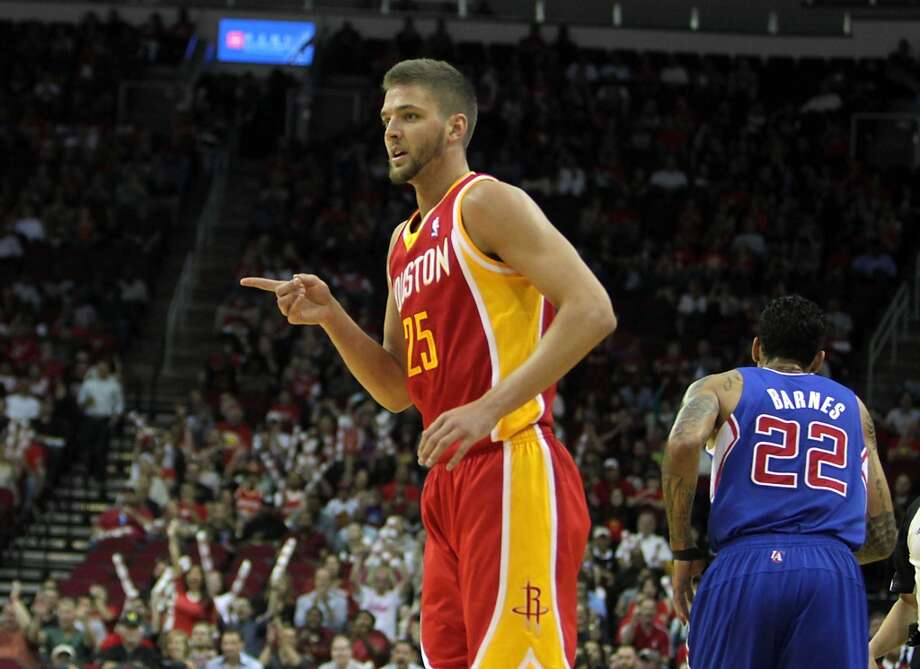 Rockets forward Chandler Parsons points his finger after making a three. Photo: James Nielsen, Houston Chronicle