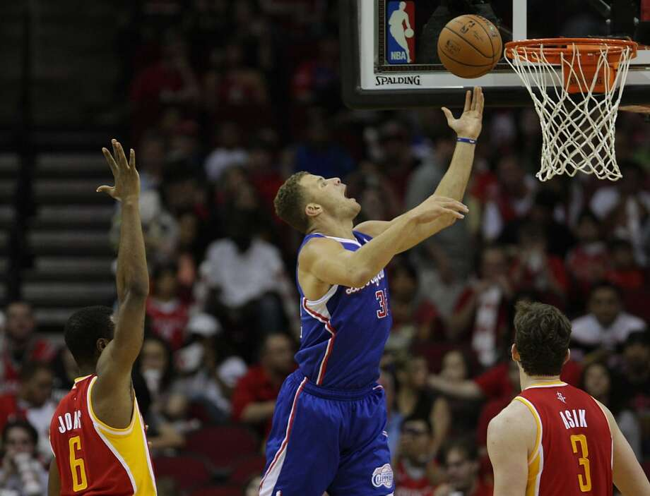 Clippers forward Blake Griffin shoots the ball as Rockets forward Terrence Jones and center Omer Asik look. Photo: James Nielsen, Houston Chronicle