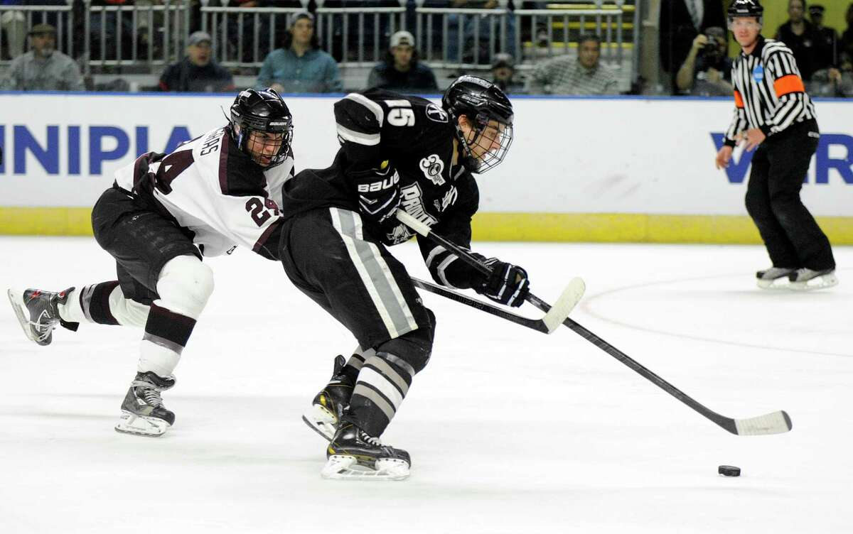 Union's Sebastien Gingras, left, chases Providence's Steven McParland during the second period of the final of the men's NCAA East Regional college hockey tournament, Saturday, March 29, 2014, in Bridgeport, Conn. (AP Photo/Fred Beckham) ORG XMIT: CTFB104