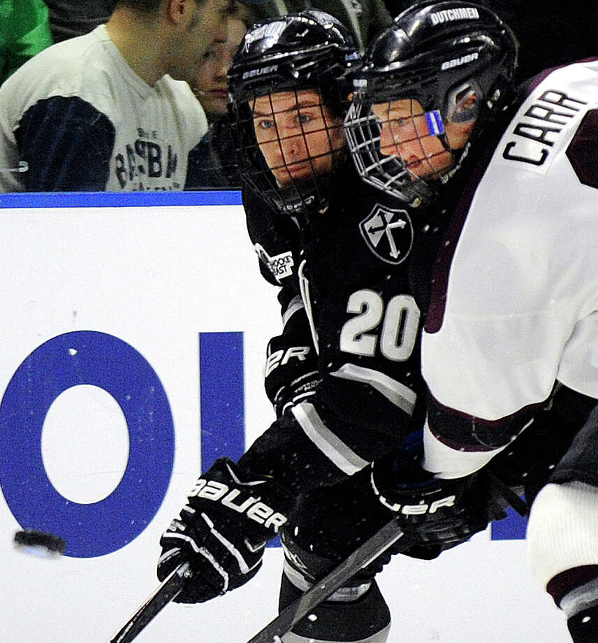 Union's Daniel Carr, right, and Providence's Shane Luke fight for the loose puck during the third period in the final of the men's NCAA East Regional college hockey tournament, Saturday, March 29, 2014, in Bridgeport, Conn. Union won 3-1. (AP Photo/Fred Beckham) ORG XMIT: CTFB210 Photo: Fred Beckham / FR153656 AP