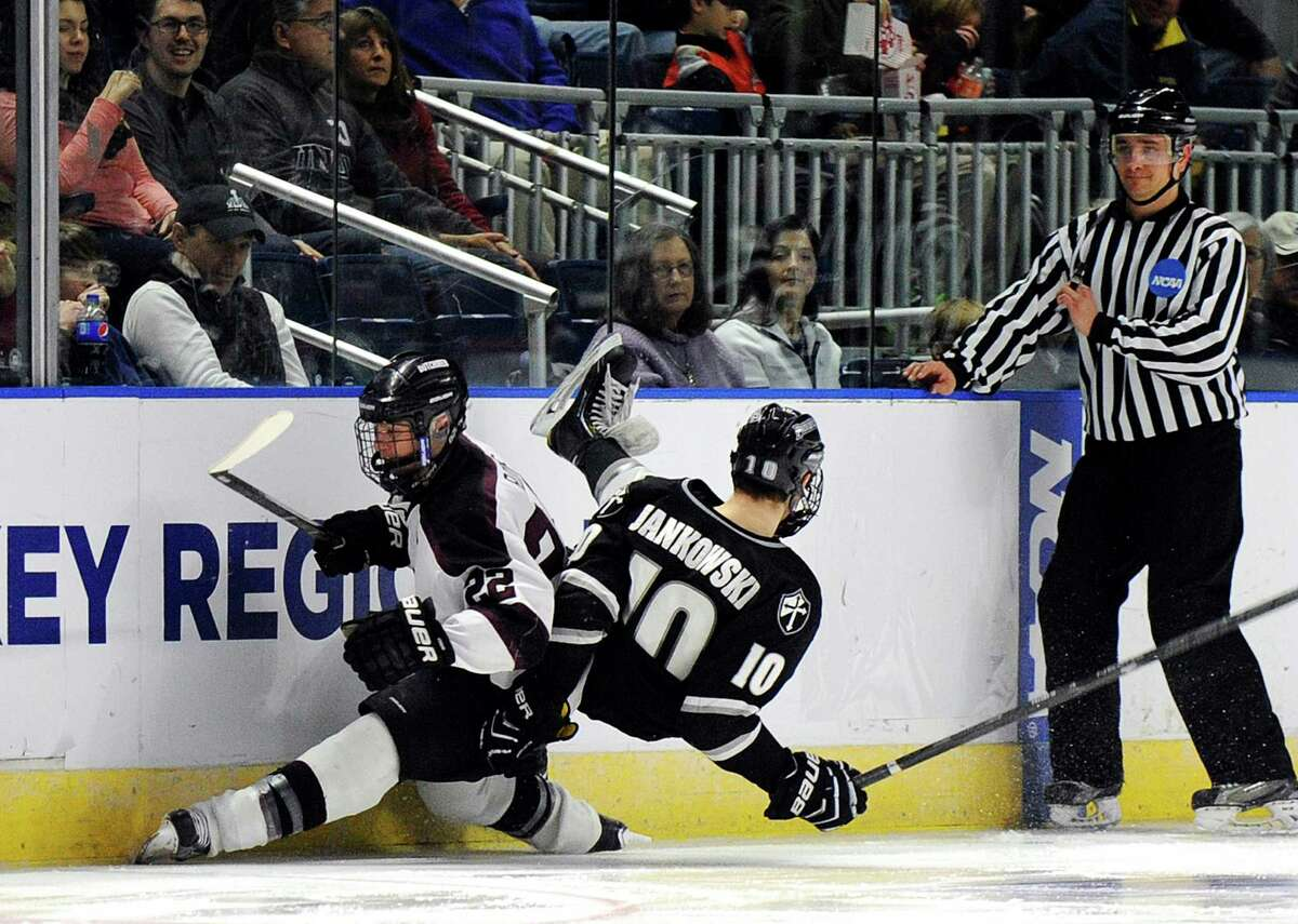 An official reacts to a collision between Union's Mat Bodie and Providence's Mark Jankowski during the third period of Union's 3-1 victory in the final of the men's NCAA East Regional college hockey tournament, Saturday, March 29, 2014, in Bridgeport, Conn. (AP Photo/Fred Beckham) ORG XMIT: CTFB111