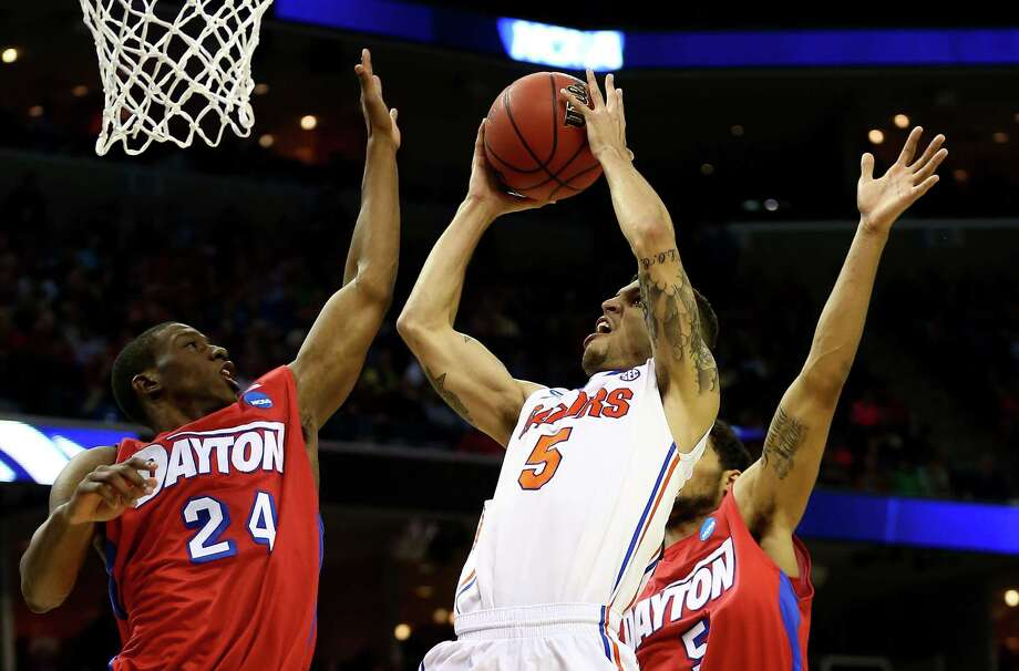 MEMPHIS, TN - MARCH 29:  Scottie Wilbekin #5 of the Florida Gators goes to the basket as Jordan Sibert #24 and Devin Oliver #5 of the Dayton Flyers defend during the south regional final of the 2014 NCAA Men's Basketball Tournament at the FedExForum on March 29, 2014 in Memphis, Tennessee.  (Photo by Streeter Lecka/Getty Images) ORG XMIT: 459542827 Photo: Streeter Lecka / 2014 Getty Images