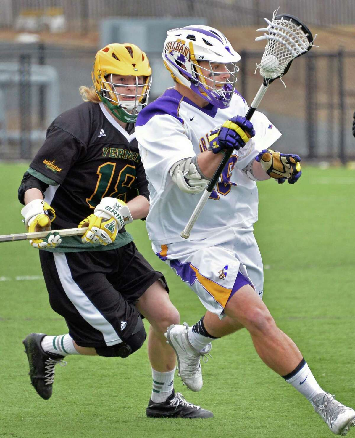 UAlbany's #16 Will Stenberg, right, gets past Vermont's #18 Hayden Jenkins during Saturday's game March 29, 2014, in Albany, NY. (John Carl D'Annibale / Times Union)