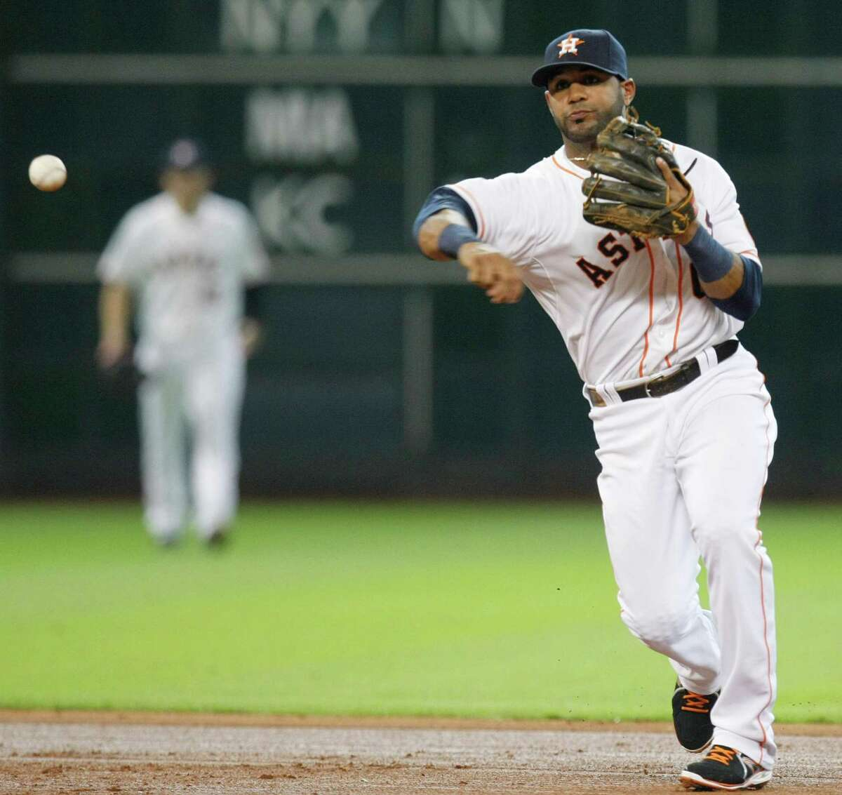 Houston Astros shortstop Jonathan Villar (6) throws out Texas Rangers center fielder Leonys Martin (2) at first base in the fifth inning as the Houston Astros played the Texas Rangers at Minute Maid Park Monday, Aug. 12, 2013, in Houston. ( Johnny Hanson / Houston Chronicle )